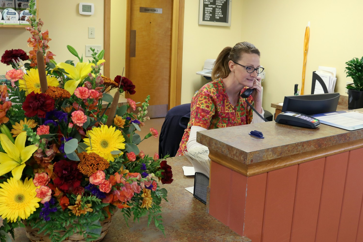 Cecelia, one of our CVT's answering phones at the front desk - Manchester Veterinary Clinic - CT - Trusted Vets For Your Pets